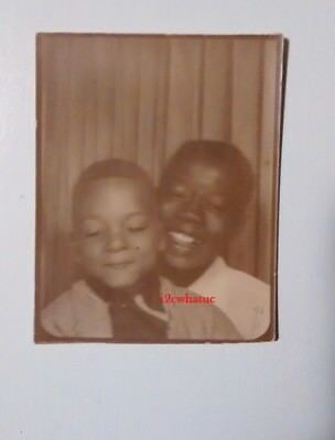 Black African American Photo Booth Mother And Bashful Son With Eyes Closed
