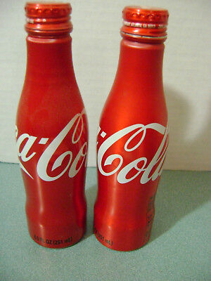 2 Coca Cola Aluminum Coke Bottles / Cans Limited Edition (1 opened,1 full) 2010