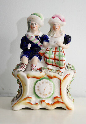 A Charming c19th Antique Victorian Staffordshire Group, a Couple upon a Clock