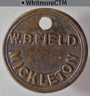 Mickleton (Yorks?) 26mm W. B. Field Uniface. Brass with off-centre hole.