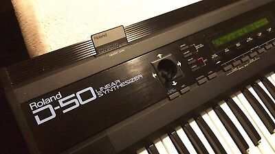 ROLAND D50 CLASSIC 80's synthesizer with PN-D50-00 rom card and midi manual