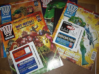 FOUR 90s UNREAD 2000AD COMICS ,THREE WITH FREE GIFTS