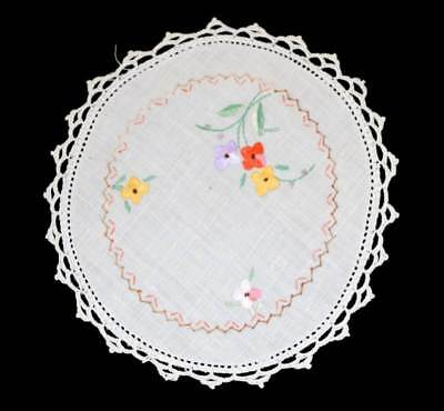 Round doily with embroidered colourful flowers