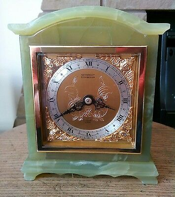 green onyx mantel clock made by elliott in excellent condition.