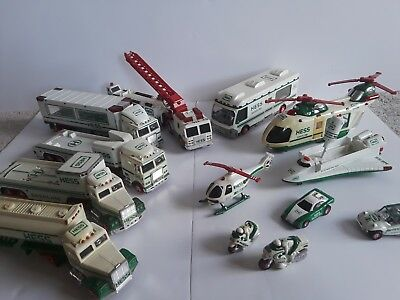 Hess 1990-2009 Lot of 11 Toy Trucks, Firetruck, Helicopter, Pad, Motorcycle, Car