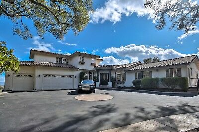 Stunning Hilltop Estate in desirable Morgan Hill on over 8 private wooded acres