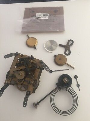 Antique brass Empire clock movement and some spares