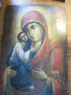 An Old Russian Orthodox Icon of Mary with Baby Jesus, on curved wood .