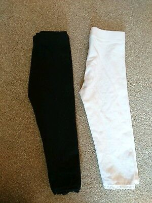 2 pairs of Girls Next Leggings. 12-18 months. Black and White.
