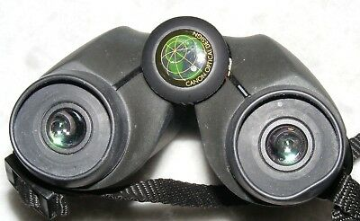 Canon, 8x23A WP good quality compact binoculars in case. Made in Japan
