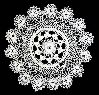 Vintage intricate white lace round doily measuring 18cm across