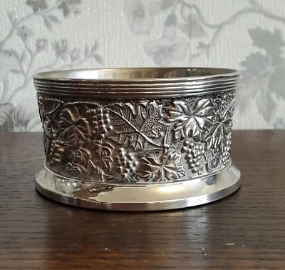 A Vintage Silver Plated Wine Coaster with Embossed Grape Design