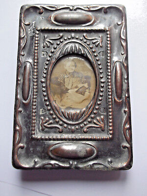 """20th cent. Art Nouveau metal PHOTO FRAME  5"""" x 3½. Sepia photo of seated child."""