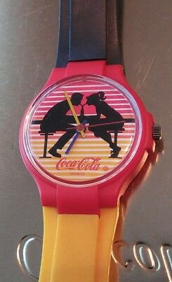 Coca cola watch colorful excellent condition classic man woman sharing drink