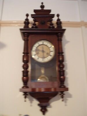 Welsh wooden cased Wall clock with strike, German movement.