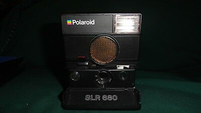 POLAROID SLR 680 AUTO FOCUS WITH BOX INSTRUCTIONS and STRAP PURCHASED NEW.