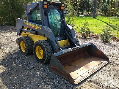 New Holland LS170 skid steer heated cab NO RESERVE