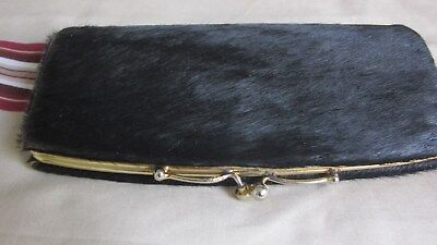 1950,s black vintage pony skin clutch purse with red lining.7 insx4ins.Used