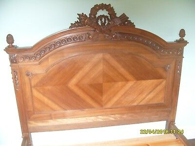Carved oak antique French double bed. Complete with slats.