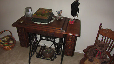 Antique Singer Sewing Machine In Oak Cabinet