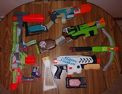 Nerf gun lot used 4 guns 1 super soaker working order sledgehammer bow