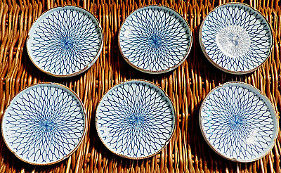 Six small signed blue and white Japanese bowls, brown trim