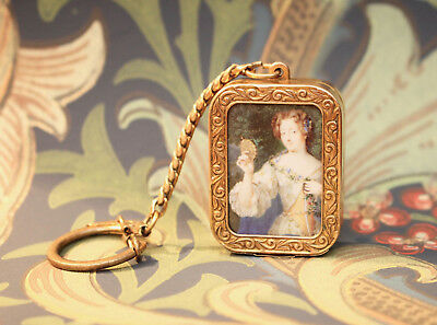 A Beautiful REUGE St Croix Musical Box Pendant, Gilt Brass, Photograph Window.