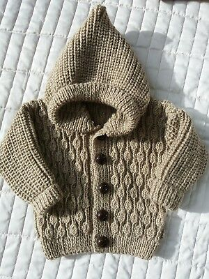 Hooded acorn patterned cardigan hand knitted. Beige. 3 - 6m. Ideal spring wear.