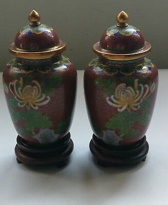 Pair of smaller Chinese cloisonne lidded jars on wooden stands. Floral