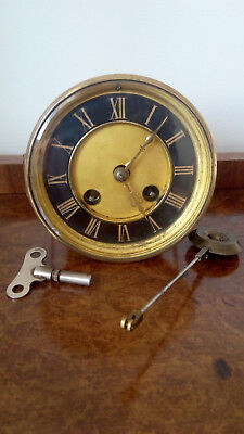 Antique Clock Movement A.D.Mougin Deux Medailles working pendulum & key