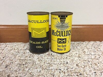 Pair of vintage McCulloch chainsaw oil cans