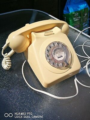 Old  rotary dial telephone cream colour