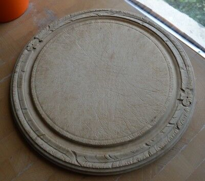 French vintage round bread board with carved design around rim & well for crumbs