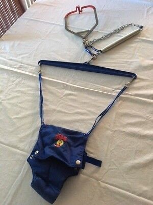 Genuine Jolly Jumper baby bouncer from clamped door frame