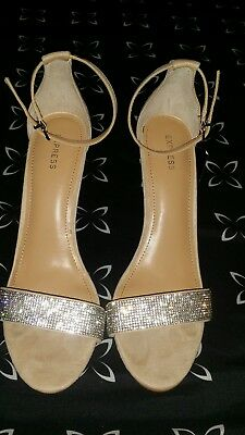 Brand New Without Box Express  Heels. Size 9.   Color Nude With Silver Band!!!!
