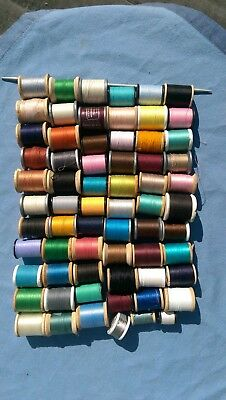 Lot of 64 Vintage Sewing Thread Spools, most barely used. Many colors.