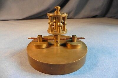 Antique torsion anniversary clock disc pendulum