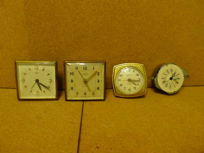 4 x Travel Alarm Clocks without cases.. Spares or repairs..