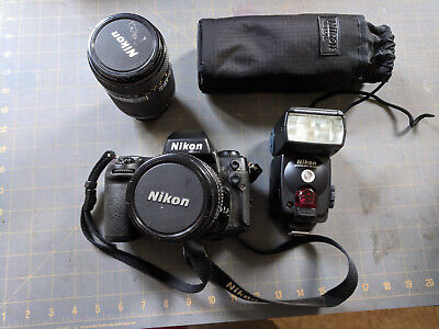 Nikon F100 SLR film camera + 2 AF Nikkor lenses + SB-80DX Flash + UCB bag