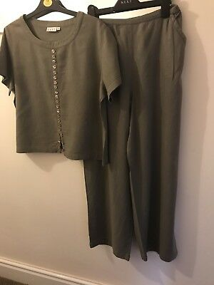 Ladies Suit By East Top size 14 and wide leg trousers size 12 elasticated waist.