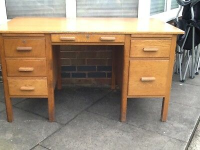 Old writing desk. Reasonable condition.Requires refurbishment.Colour light brown