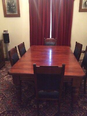 Antique Dining Table and 6 Chairs. Table/chair legs have carved patterns.