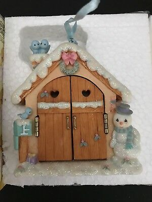 This Enesco Precious Moments hinged hanging Christmas Ornament, Girl w/presents