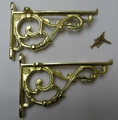 PAIR OF SMALL LIPPED BRASS cast iron ornate shelf support wall brackets