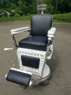 Antique barber chair Emil J Paidar with headrest - porcelain and leather