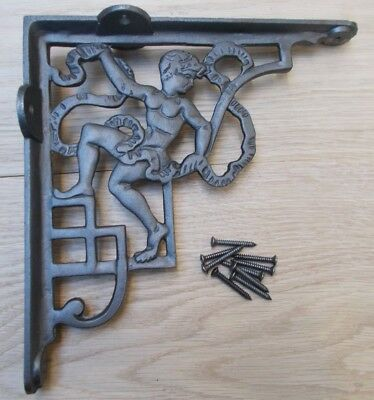 PAIR OF CHERUB ANTIQUE IRON  cast iron rustic shelf support wall brackets