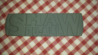 Shaw Du-All tractor badge