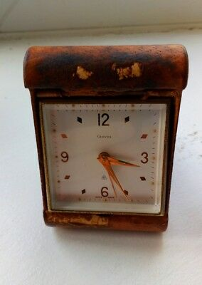vintage leather folding  Swiss 8 day alarm clock with the c.249 lever escapement