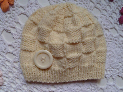 Cosy hand-knitted baby beanie with button, fits 3-6 months, wool/acrylic yarn