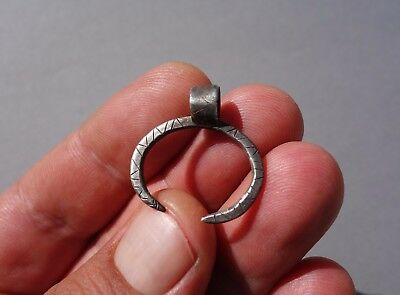 Viking silver crescent moon,in shape of curved dragon amulet,pre-pagan origins